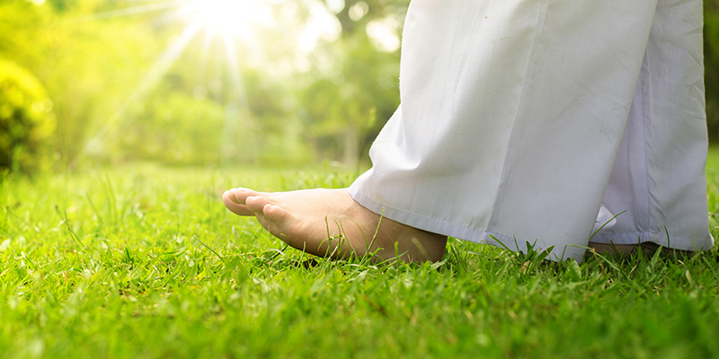 picture of feet on grass - movement meditation - A Brief Introduction to Different Meditation Styles - happiness.org